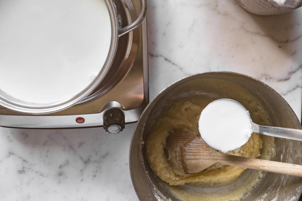 adding milk besciamella