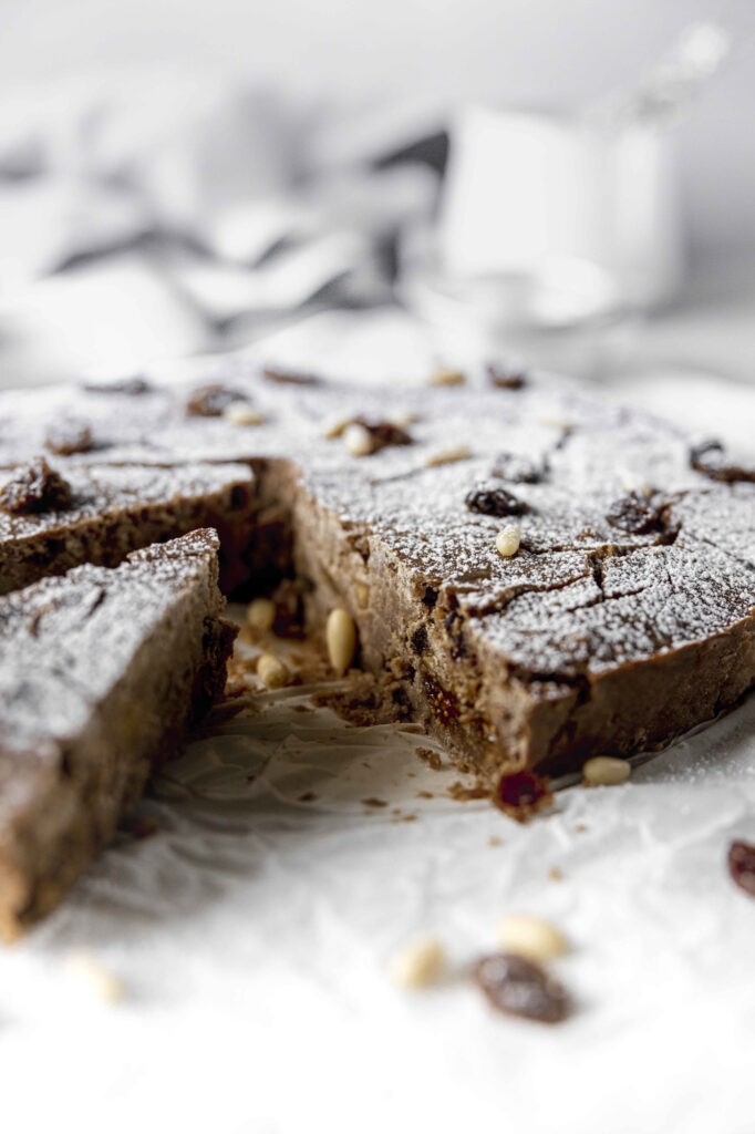 Italian chestnut flour cake with raisins, vanilla and dried figs: castagnaccio alla ferrarese