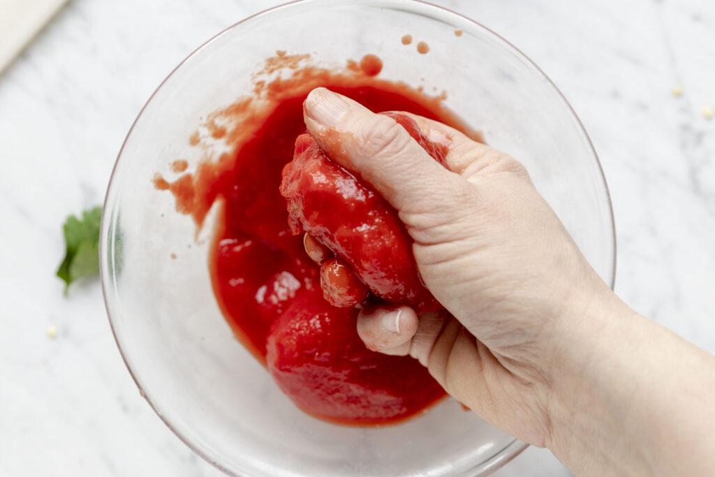 crushing tomatoes