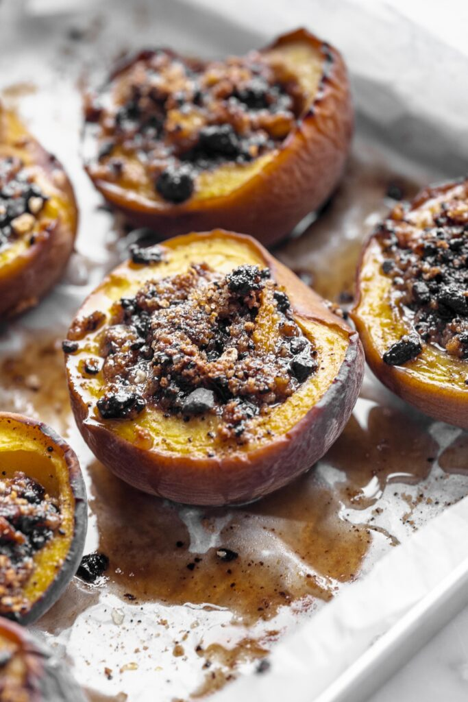 Baked amaretti and chocolate stuffed peaches